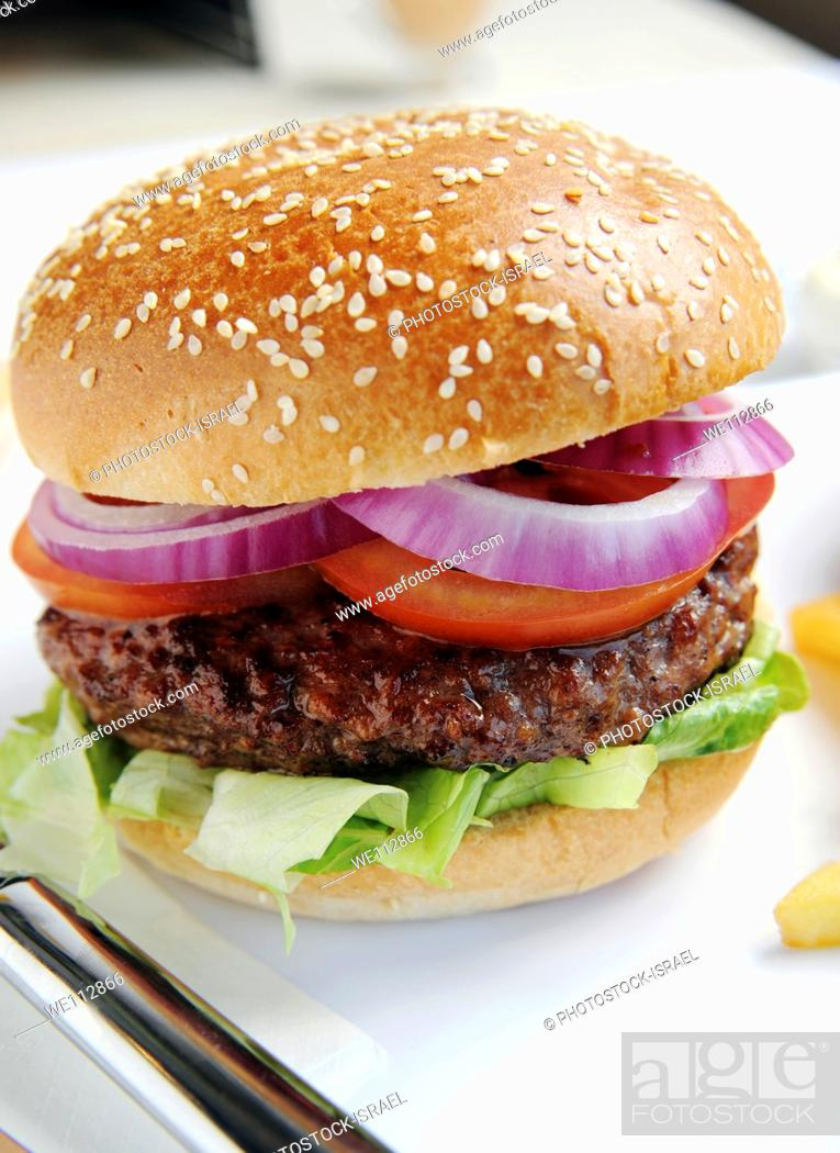 Stock Photo: Hamburger with red onions.