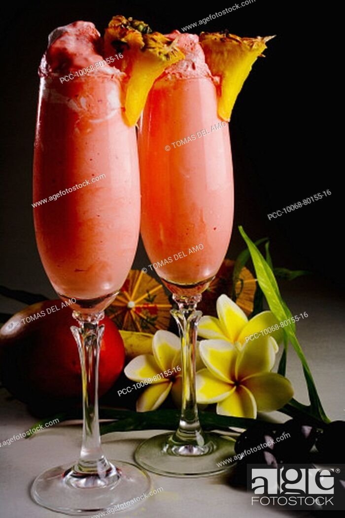 Stock Photo: Close-up of two glasses filled with a creamy pink tropical drink.