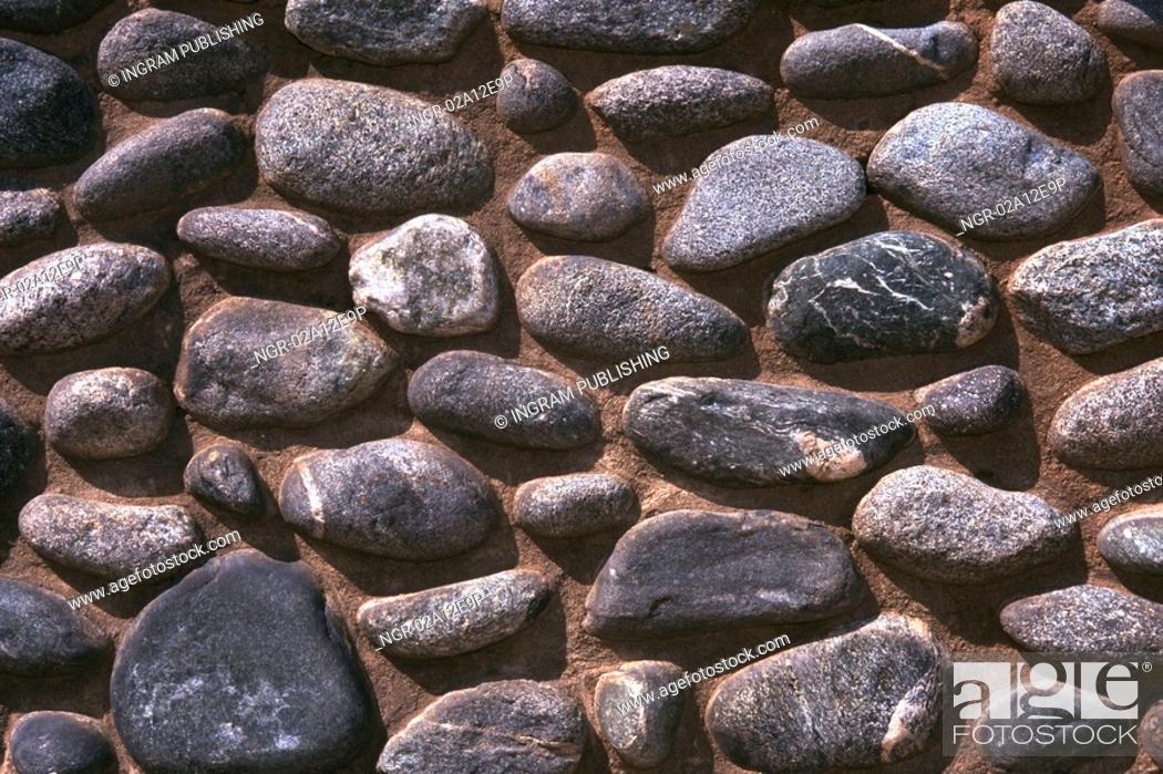 Stock Photo: Close-up of a rocks embedded in a wall.