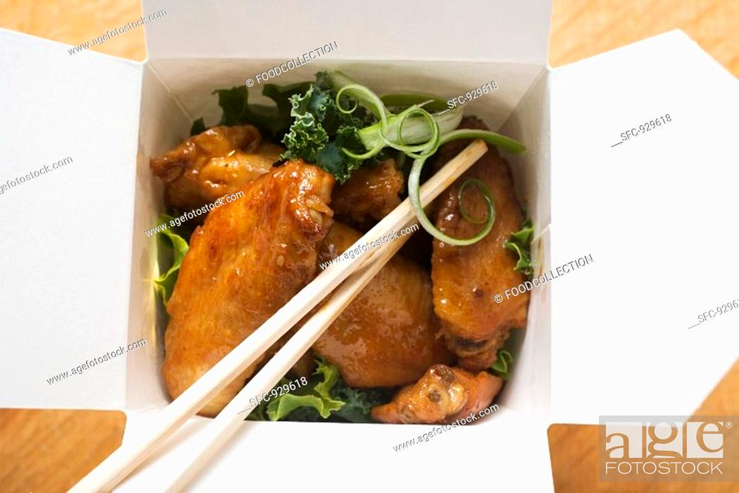 Stock Photo: Chicken wings to take away.