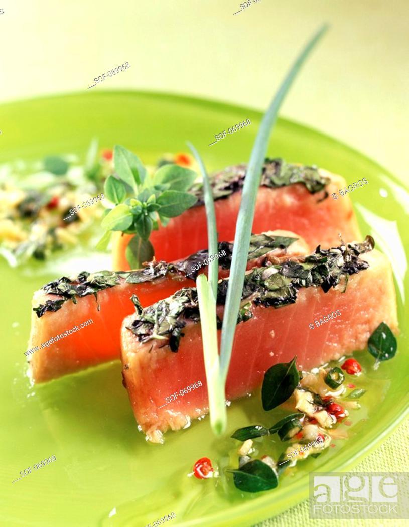 Stock Photo: half-cooked tuna with herb crust.