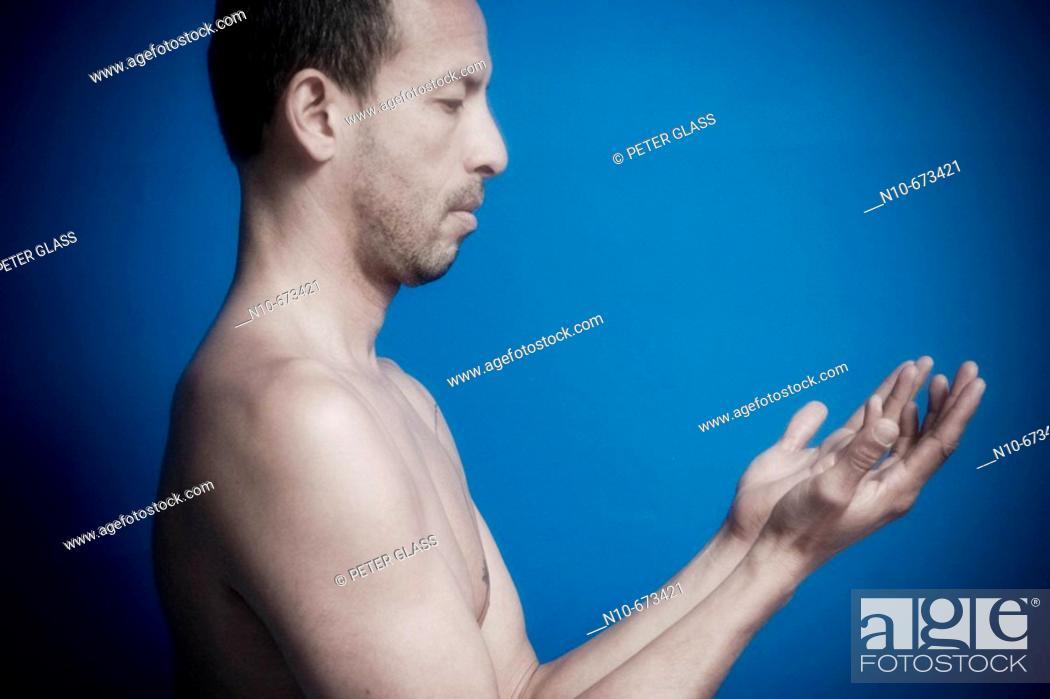 Stock Photo: Hispanic man posing without a shirt.