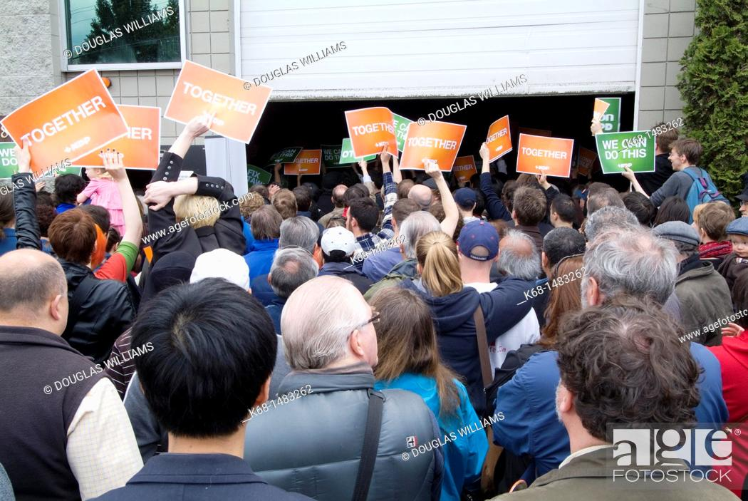 Stock Photo: A woman holds a sign at a political rally for the New Democratic Party, NDP, before the federal election in Canada, 2011, in Burnaby, British Columbia, Canada.