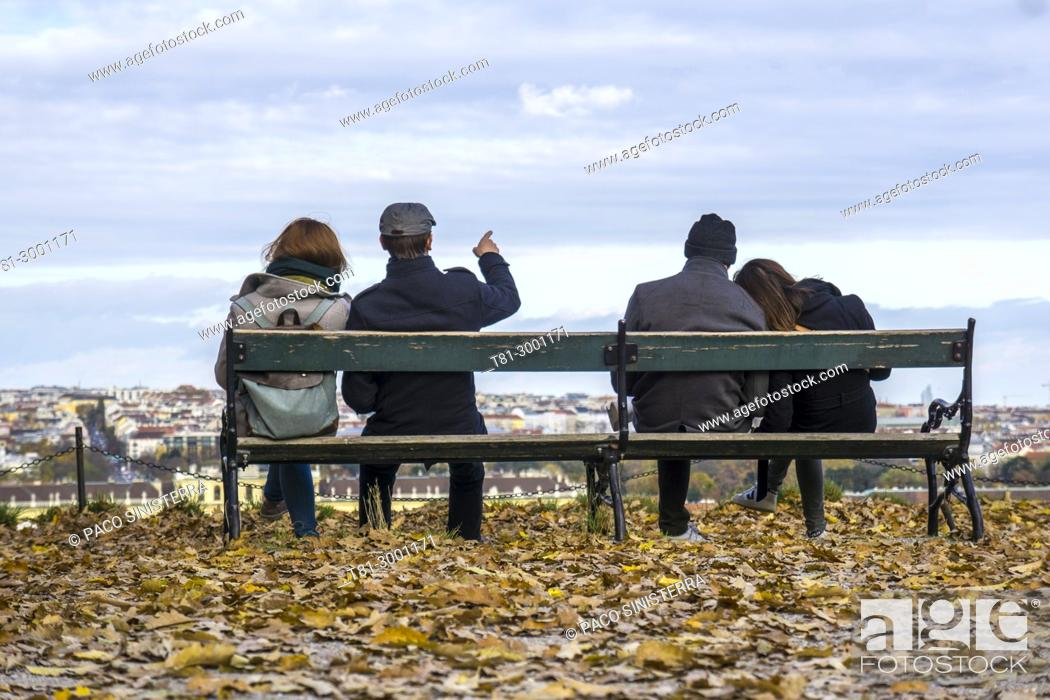 Stock Photo: couples on a garden bench looking at the sky of Vienna, Austria.