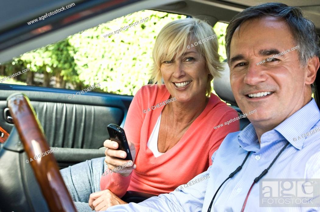 Stock Photo: Couple in a car and smiling.
