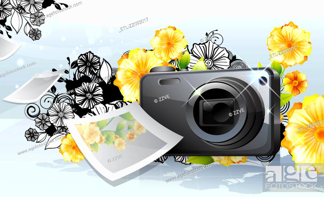 Stock Photo: Photo camera and photo, with flora design.