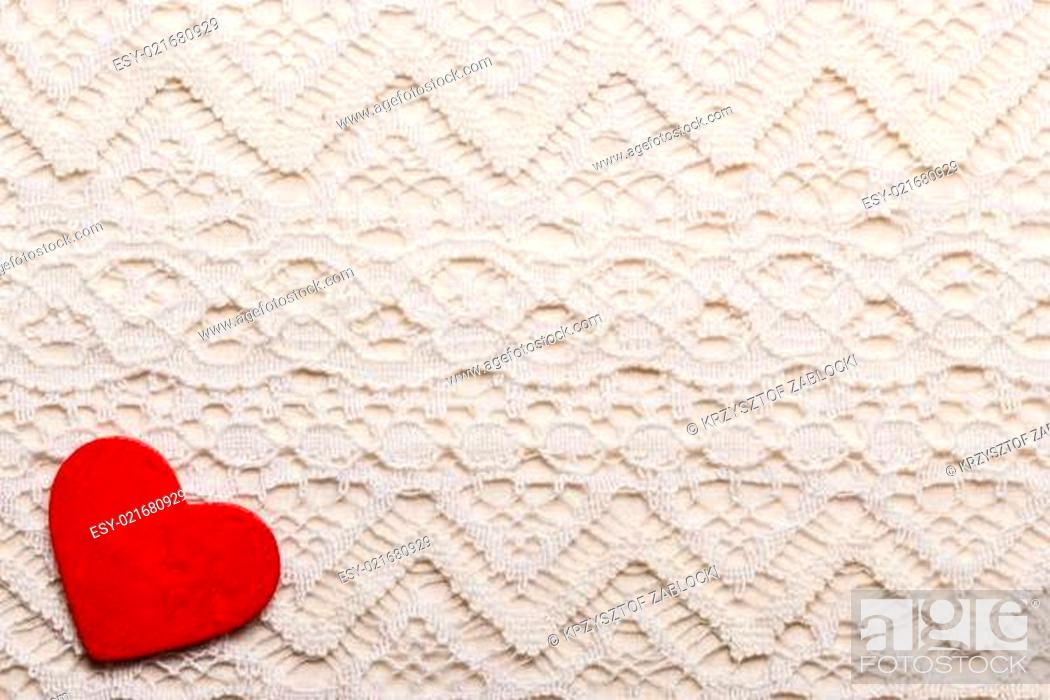 Stock Photo: Red heart love symbol on lace background.