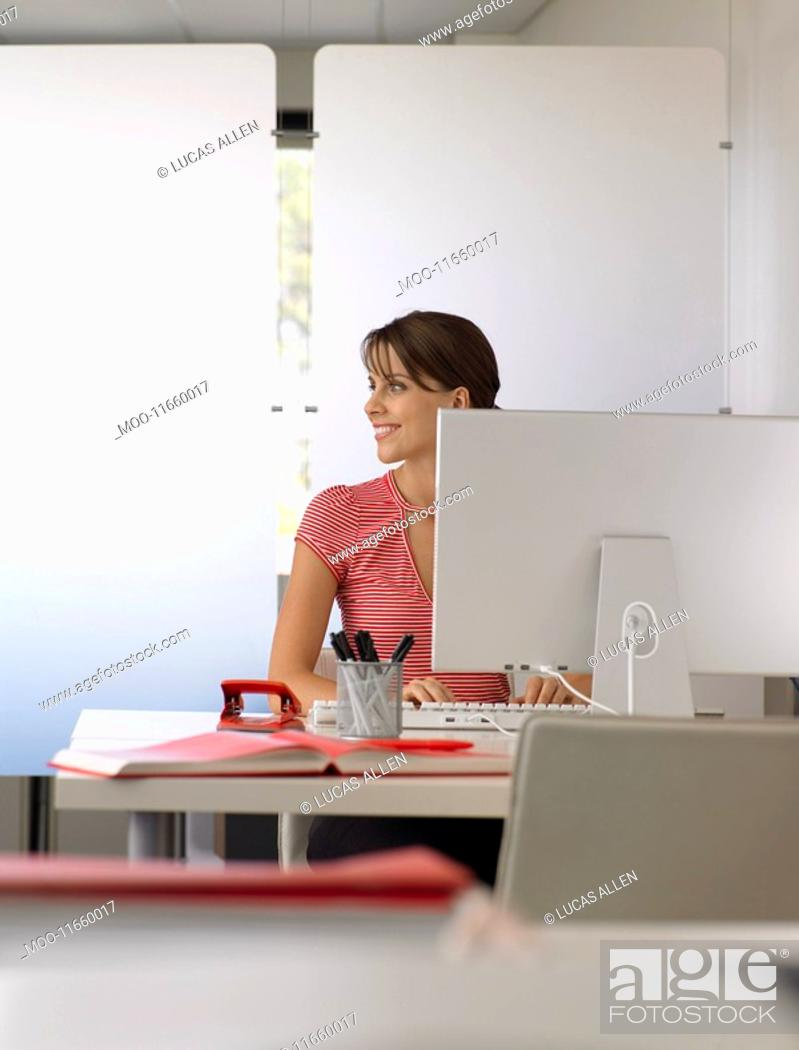 Stock Photo: Businesswoman at desk half length.