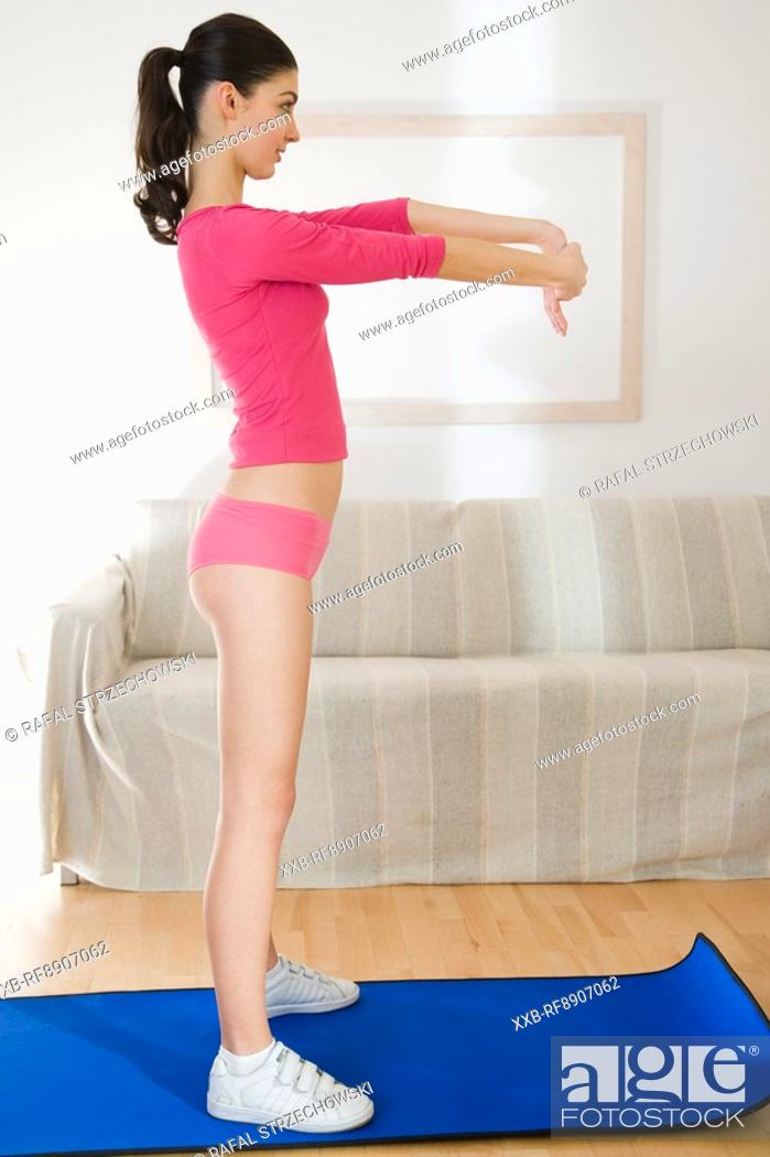 Stock Photo: woman streaching hands.