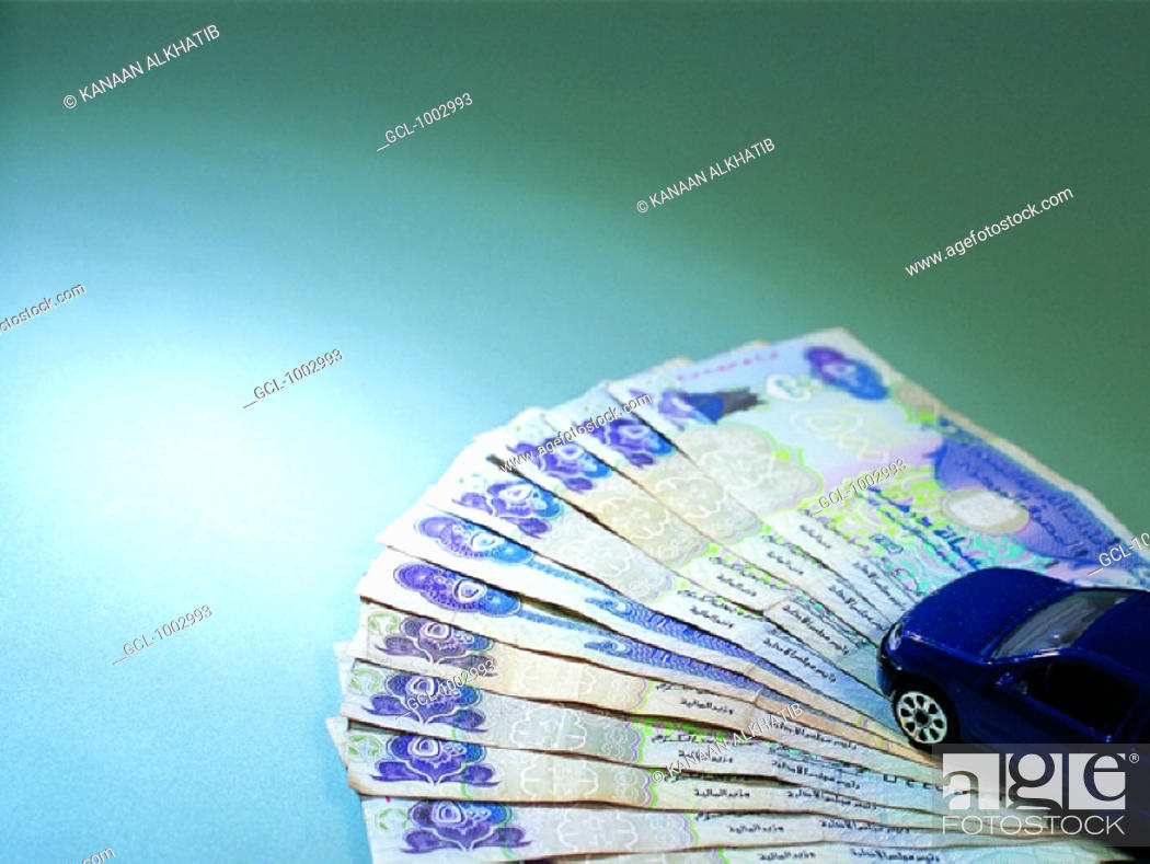 Stock Photo: Toy car and United Arab Emirates banknotes.