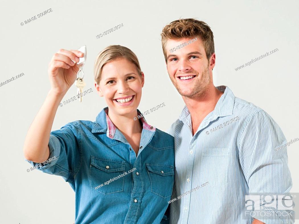 Stock Photo: Young couple holding house keys.