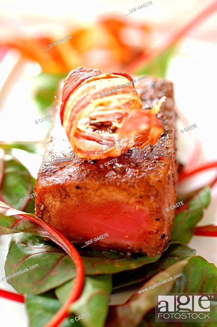 Stock Photo: caramelized roast tuna with spices.