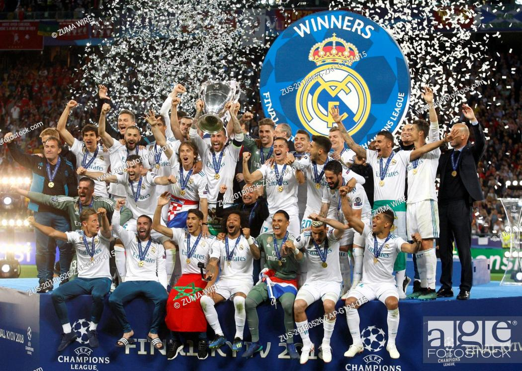 Stock Photo: May 26, 2018 - Kiev, Ukraine - Real Madrid players celebrate with the trophy after winning the UEFA Champions League final soccer match Real Madrid vs Liverpool.