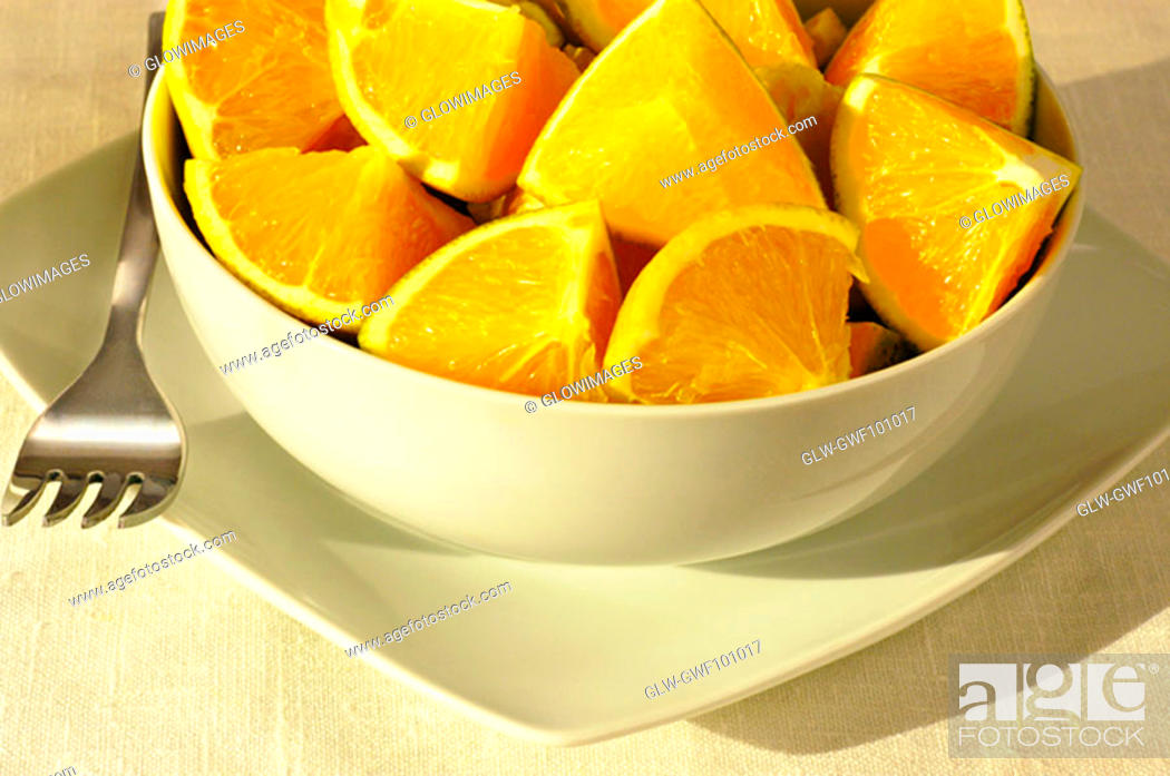 Stock Photo: Close-up of slices of orange in a bowl.