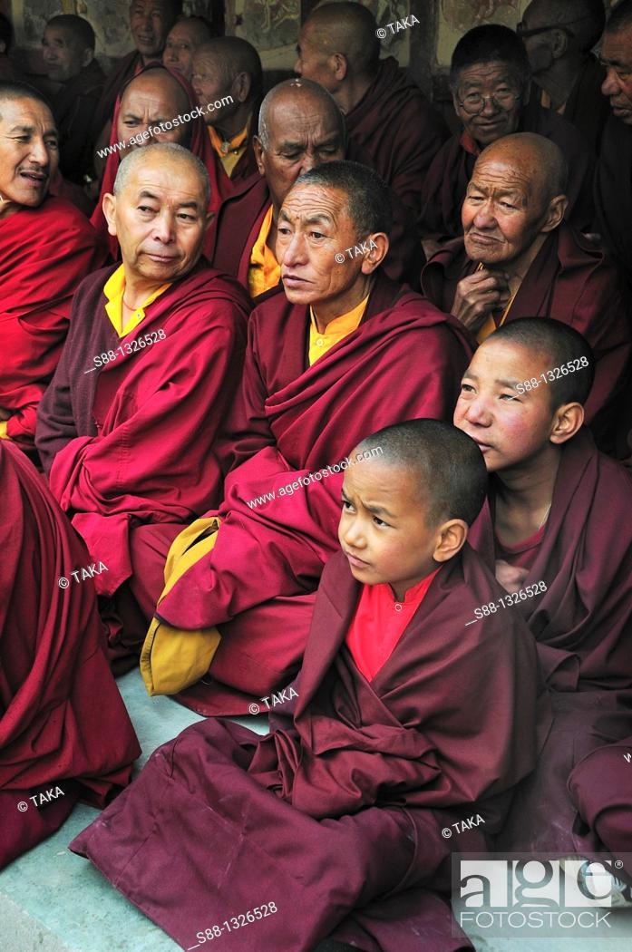 Stock Photo: Monks watching Chaam Musk Dancing at Hemis Gompa. Jammu and Kashmir, India.