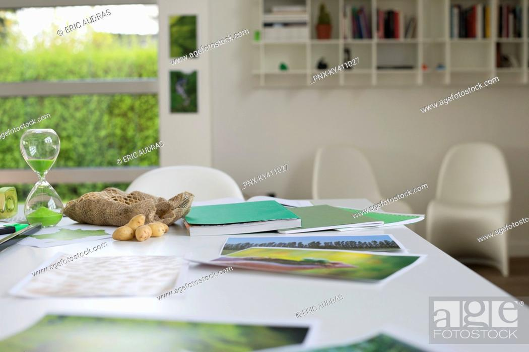 Stock Photo: Ecology sustainable development related photographs on a table.