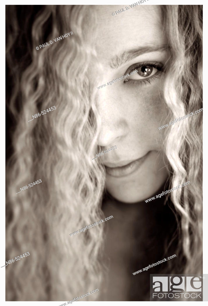 Stock Photo: Blonde woman with curly hair.