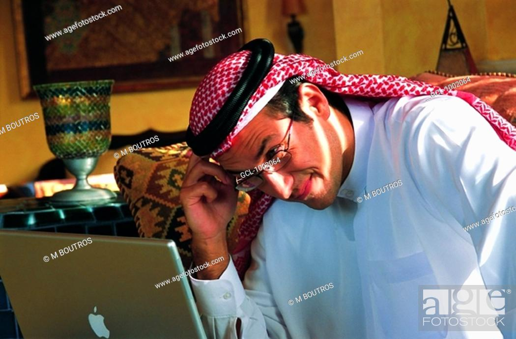 Stock Photo: Arab businessman using a laptop.