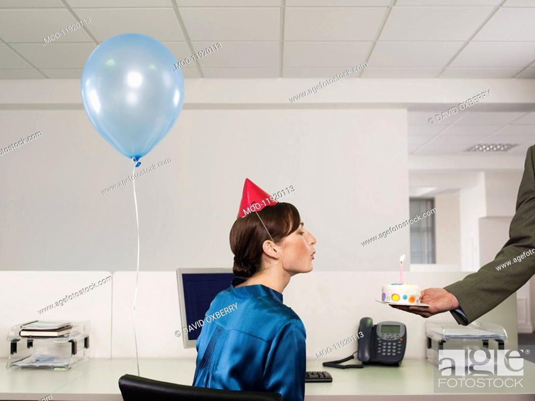 Stock Photo: Woman having birthday party in office.