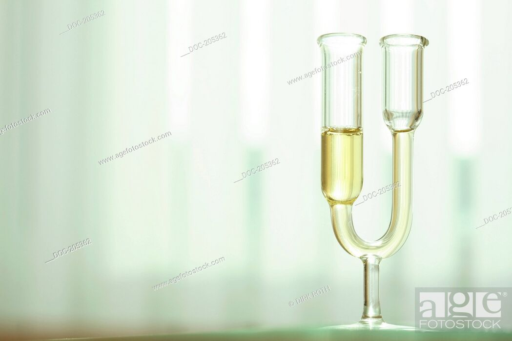 Stock Photo: diagnosis of metabolism disorder in the urine with nitric acid in u-shaped glass tube .