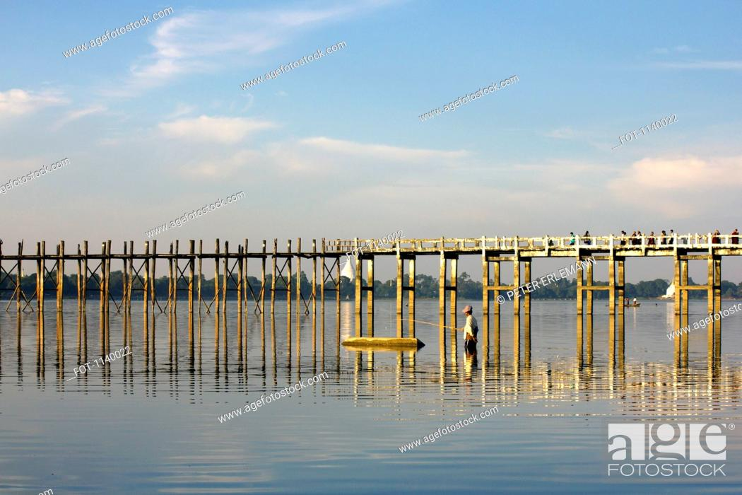 Stock Photo: A man fishing next to U Bein Bridge, Amarapura, Burma.