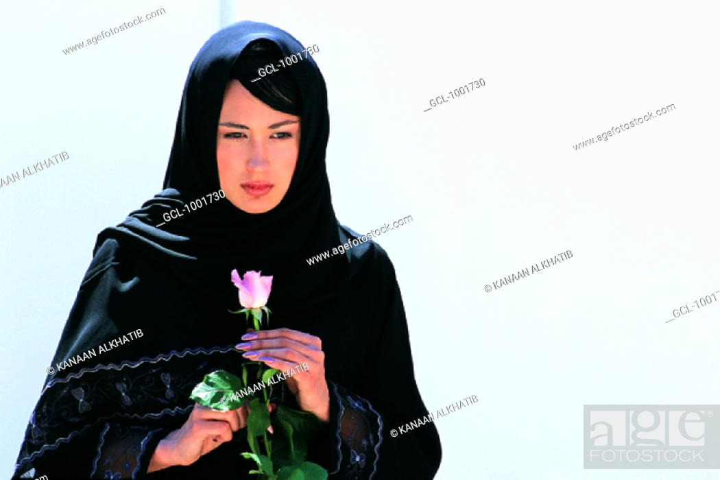 Stock Photo: Woman with rose in her hands.