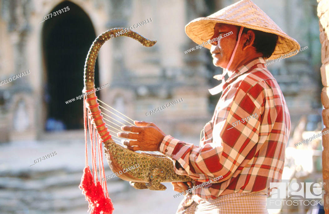 Stock Photo: Man playing the Burmese harp. Bagan. Myanmar (Burma).