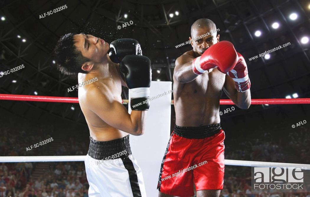 Stock Photo: Two men Boxing with one being hit.