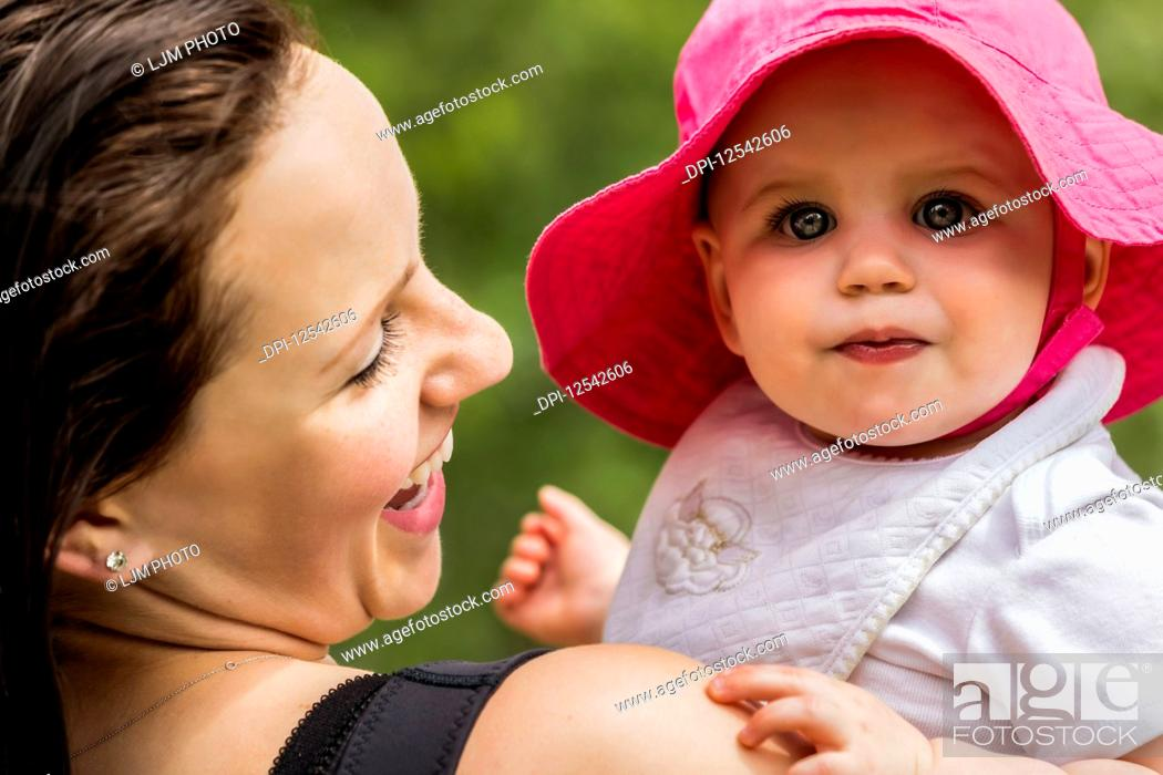 Stock Photo: A young mother spending quality time with her daughter in a park during the summer; Edmonton, Alberta, Canada.