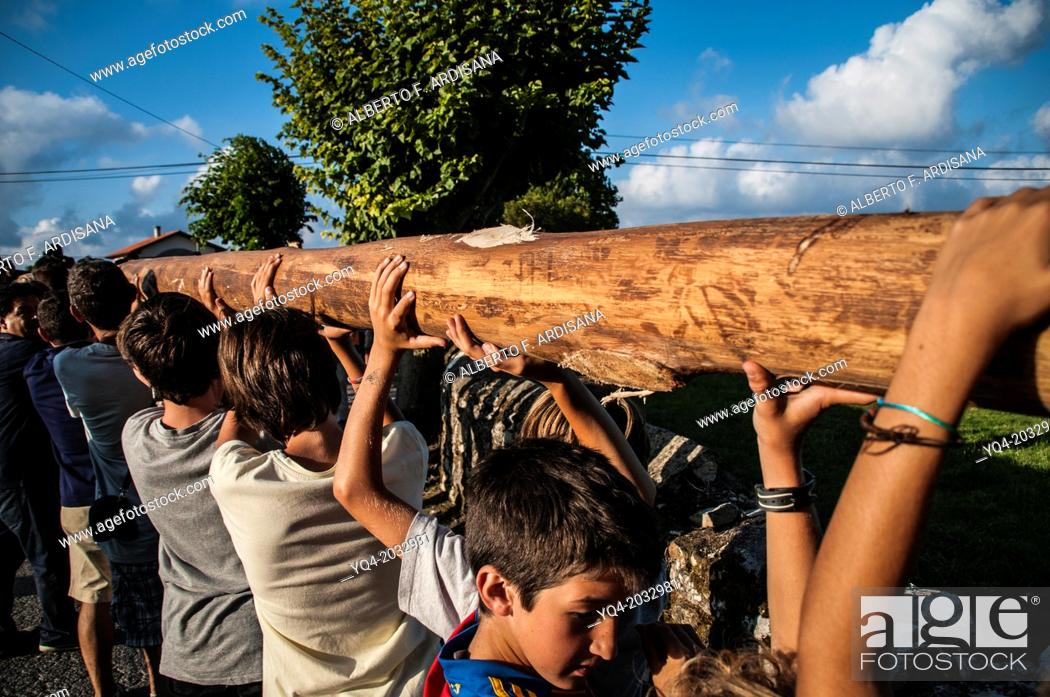 Stock Photo: People carrying a log. Tradition of planting the stake. Llanes, Asturias. Spain.