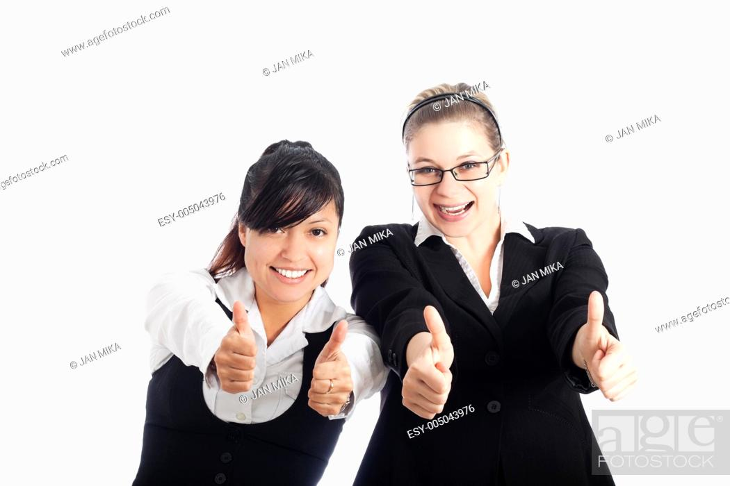 Stock Photo: Two young happy business women gesturing thumbs up, isolated on white background.