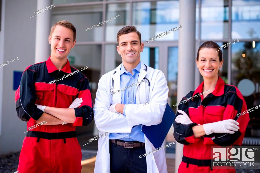 Stock Photo: Portrait of doctor and paramedic standing with arms crossed.