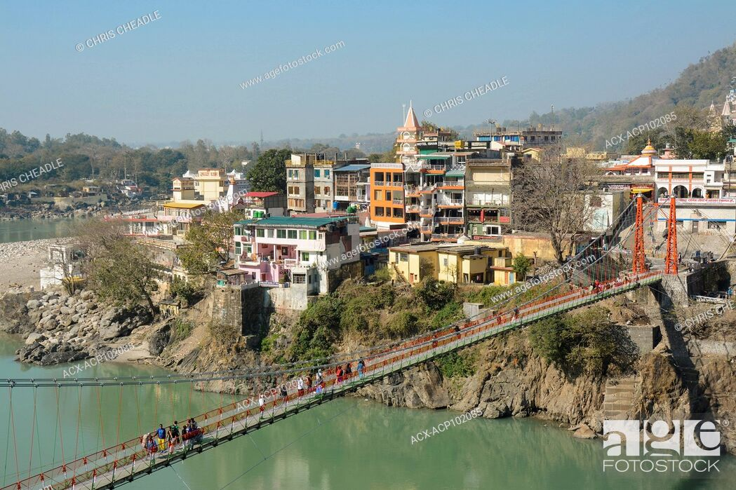 Stock Photo: Lakshman Jhula, a bridge crossing the Ganges at Muni Ki Reti, near Rishikesh, Tehri Garhwal district, Uttarakhand, India.