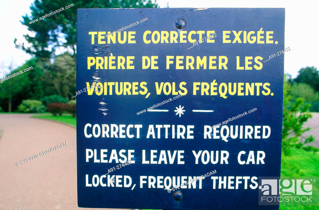 Stock Photo: Sign reminding visitors to be well dressed and beware thefts. St. James Military Cimetery. Avranches. Manche. Normandy. France.