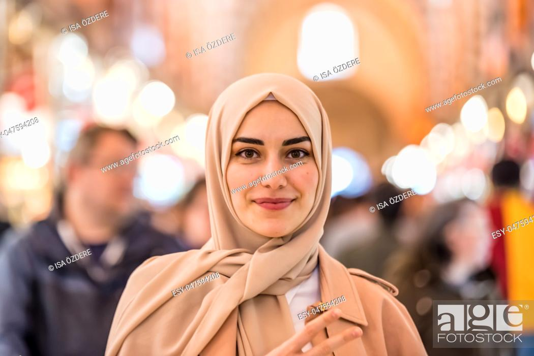 Stock Photo: Portrait of beautiful Muslim woman in headscarf and fashionable modern clothes looking at camera. Modern Muslim women lifestyle business or travel tourist.