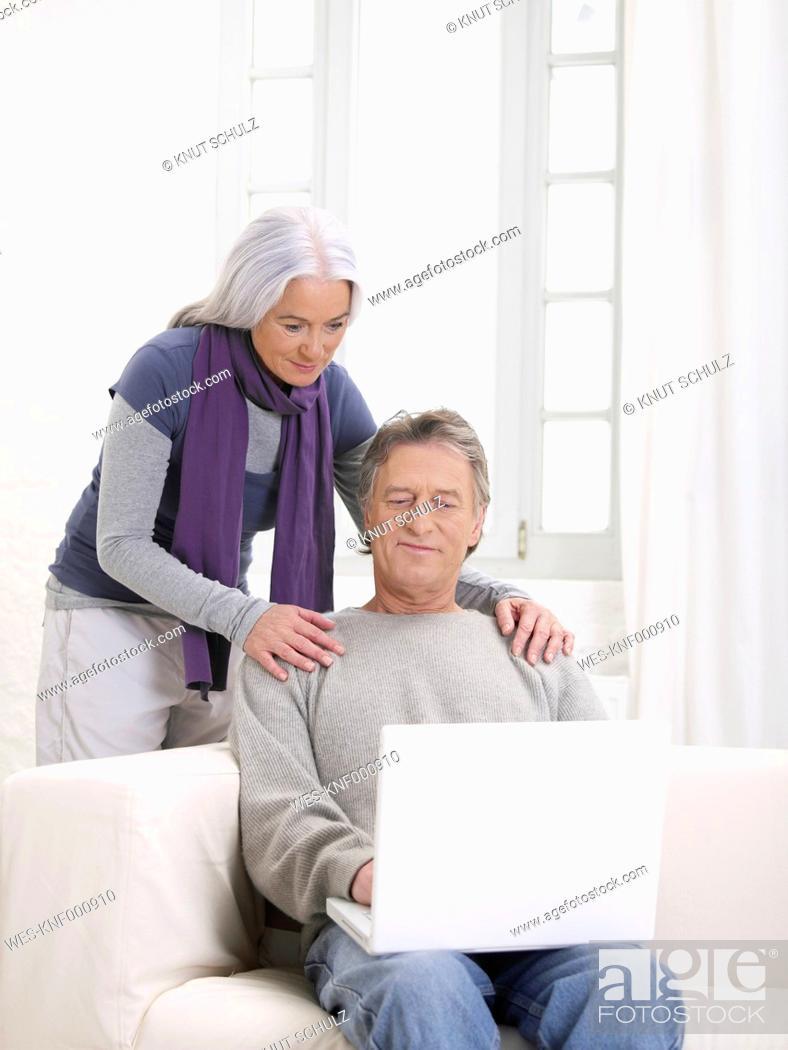 Stock Photo: Germany, Hamburg, Senior couple using laptop.