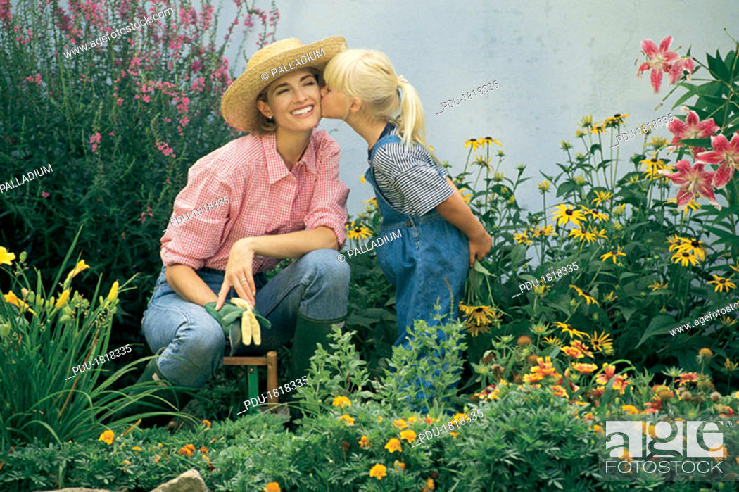 Stock Photo: Mother and daughter outside in a garden.