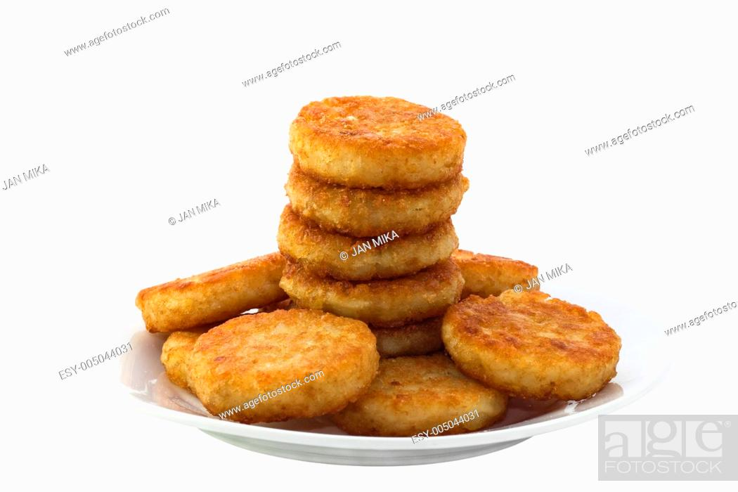 Stock Photo: Hash browns on white plate Image is isolated on white background with clipping path.