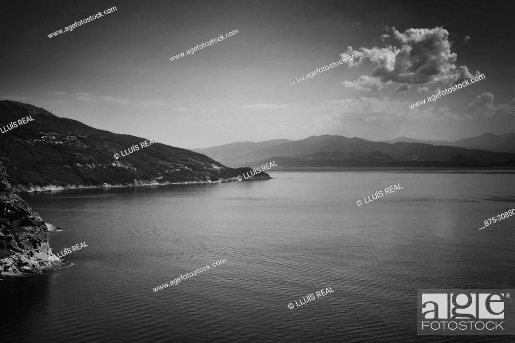 Stock Photo: Corsega coastline, clouds . Corsega, Mediterranean Sea, France.