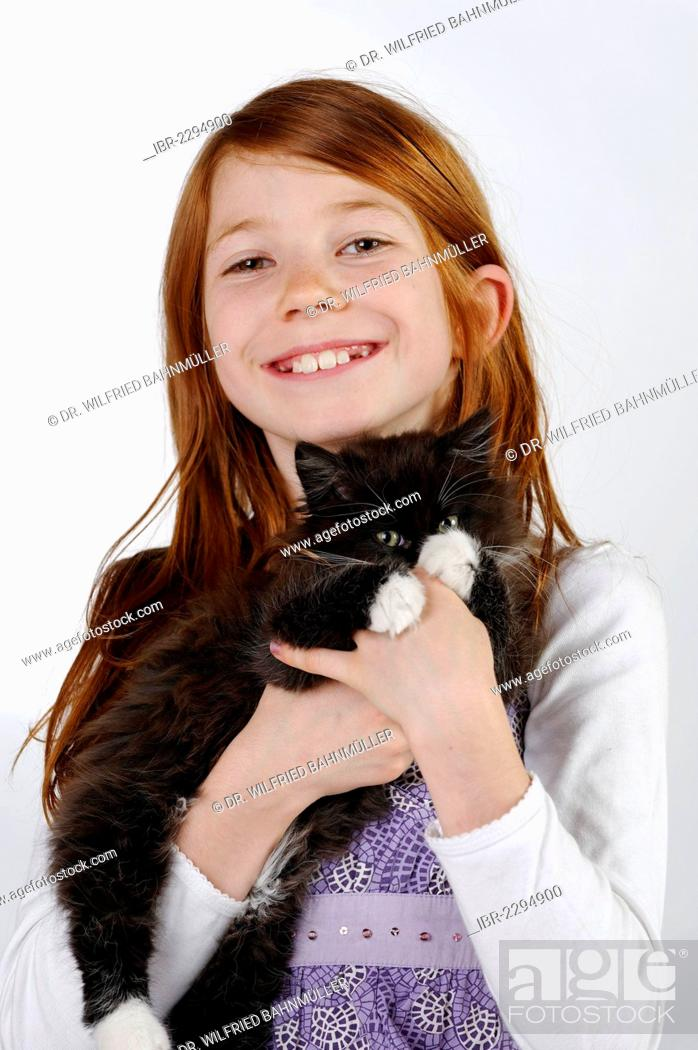 Stock Photo: Girl holding a young cat.