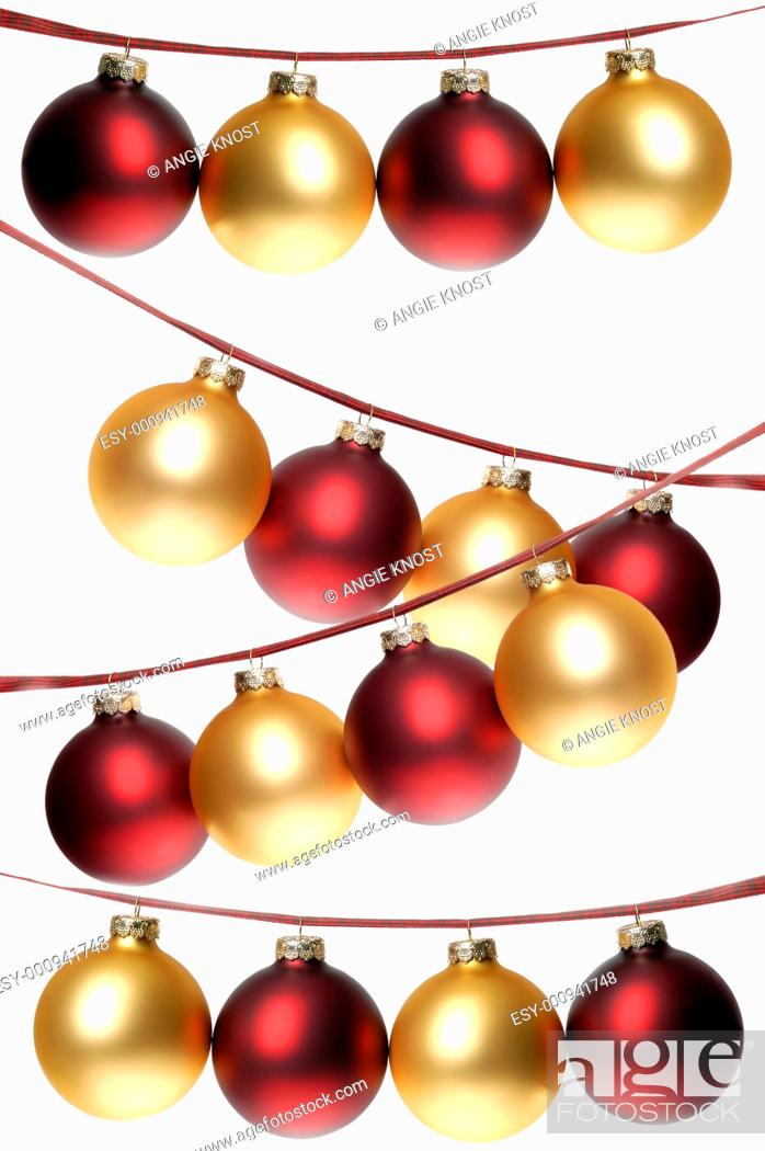 Stock Photo: White background with multiple rows of red and gold Christmas ornaments dangling from plaid ribbon.
