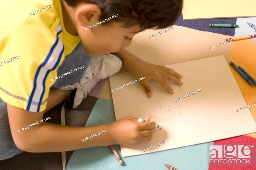 Stock Photo: Portrait of Hispanic boy drawing.