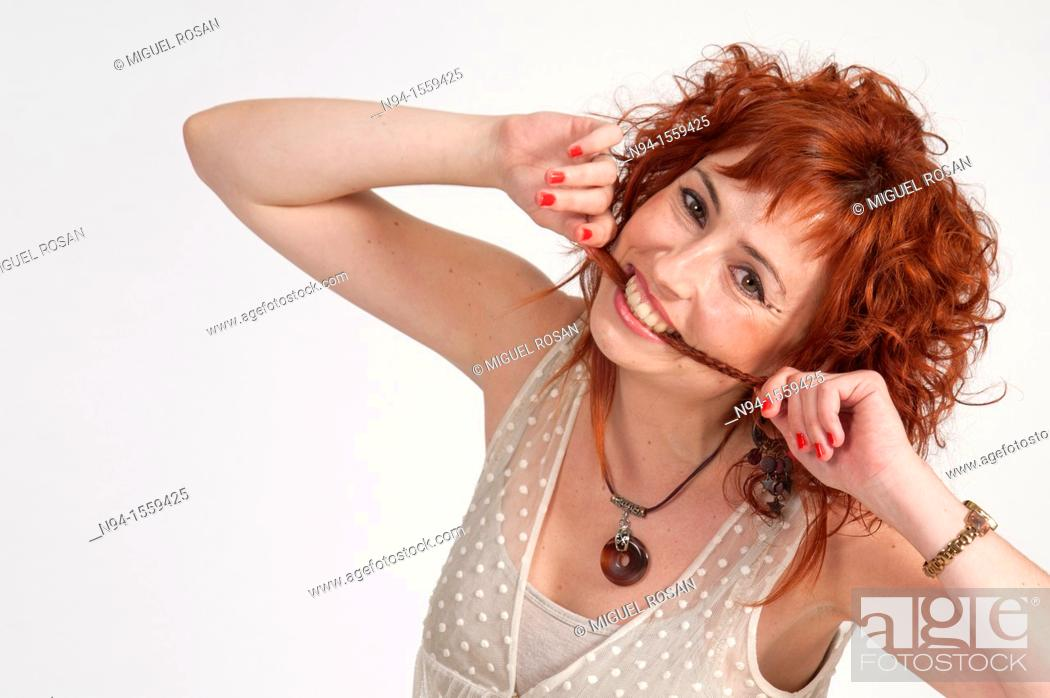 Stock Photo: Young woman posing redhead during a study session.