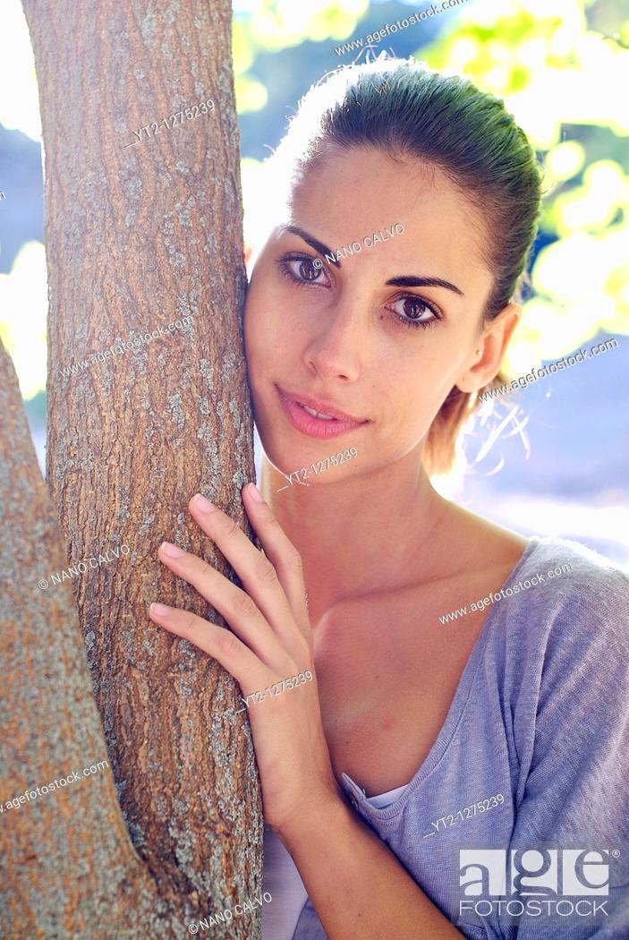 Stock Photo: Young attractive spanish woman in nature.