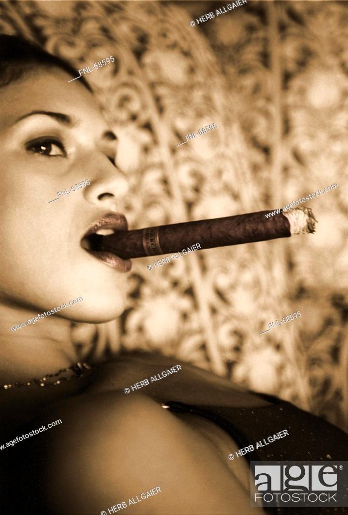 Stock Photo: Woman smoking a cigar.