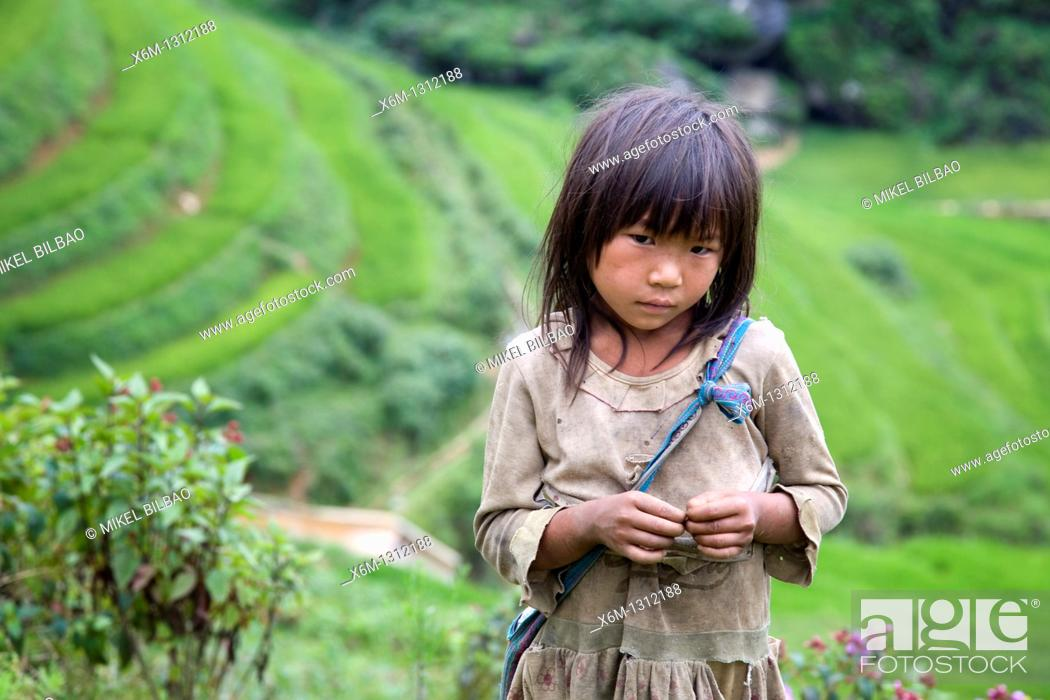 Stock Photo: girl in Sapa-Ta Phin treeking road  Sapa, Lao Cai province, Vietnam.