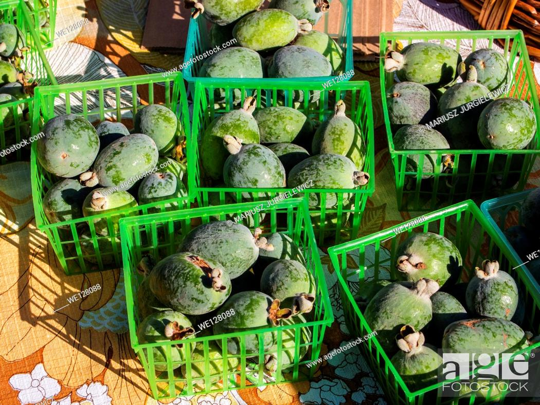 Stock Photo: Baskets of fresh pineapple guava for sale at local farmers market.