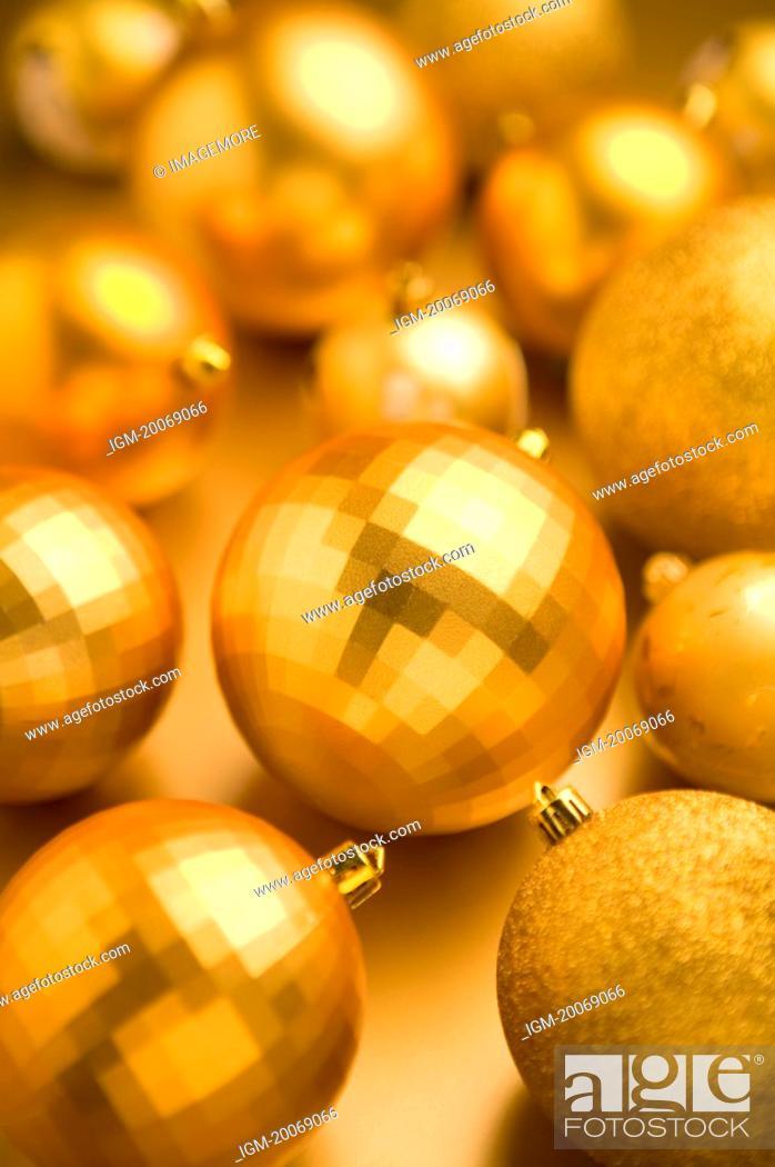 Stock Photo: Golden Christmas baubles.