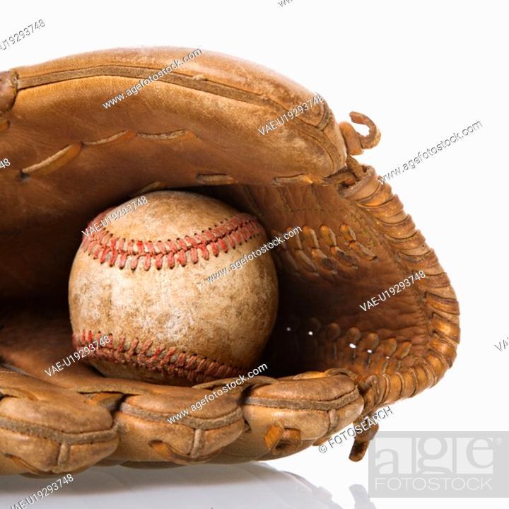 Stock Photo: Baseball resting in baseball glove.