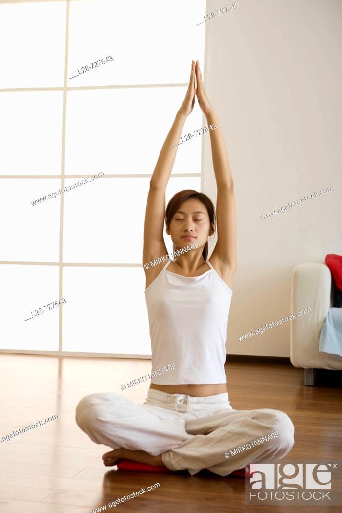 Stock Photo: Woman doing yoga at Home.